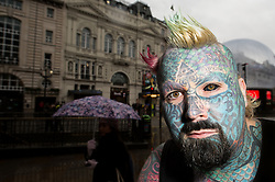 © Licensed to London News Pictures. 20/11/2013. London, UK. The launch of Ripley's Beleive It Or Not! Annual at Piccadilly. Featured is Mathew Whelan from Birmingham who has legally changed his name to King of Ink Land King Body Art The Extreme Ink-Ite. He features in the book with 80% percent of his body covered in ink having spent £20,000 and 300 hours in the tattooist's chair. Photo credit : Simon Ford/LNP
