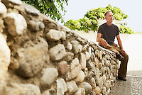 Tourist sitting on Stone Wall in Granada Spain