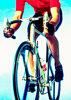 A cropped studio shot of a cyclist on a road racing bike.