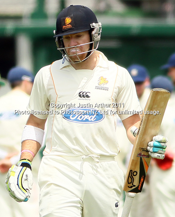Stewart Rhodes reacts to his dismissal. Plunket Shield cricket - Wellington Firebirds v Otago Volts, day one at Hawkins Basin Reserve, Wellington, New Zealand on Tuesday 29 November 2011. Photo: Justin Arthur / photosport.co.nz