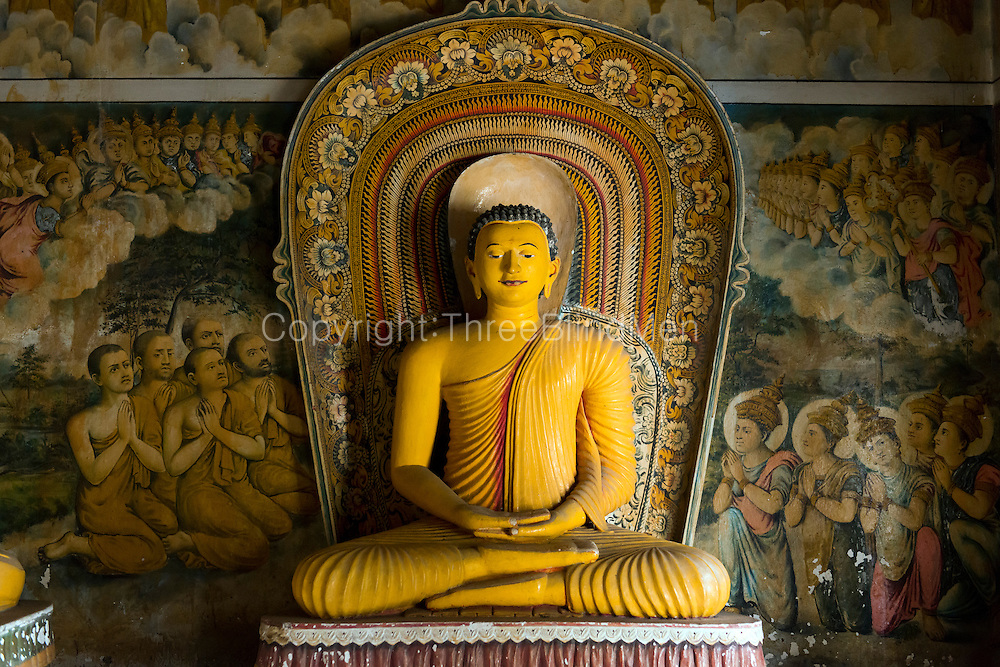Buddha statue at small shrine.<br /> Subodharmaya Temple at Dehiwala. This temple complex has fine examples of Buddhist art and architecture. Dehiwala is a suburb of Colombo, just South of the city.