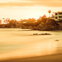 California Laguna Beach sunset panorama photo at Shaw's Cove. Laguna Beach is a Southern California beach city along the Pacific Ocean in Orange County. Panoramic photo ratio is 1:3.