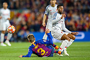Barcelona defender Gerard Piqué (3) tackles Liverpool midfielder Georginio Wijnaldum (5) during the Champions League semi-final leg 1 of 2 match between Barcelona and Liverpool at Camp Nou, Barcelona, Spain on 1 May 2019.