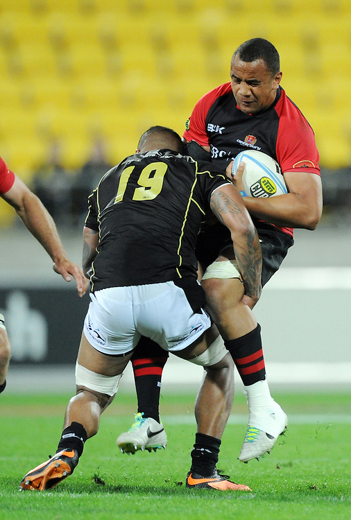 Canterburys' Nasi Manu is tackled by Wellingtons' Faifili Levave in the ITM Cup Rugby Premiership Final at Westpac Stadium, Wellington, New Zealand, Saturday, October 26, 2013. Credit:SNPA / Ross Setford