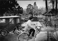 Traffic resulting from the burgeoning tourist industry around the temples of Angkor has increased many fold since the photographer's first visit in 2002, Bayon Temple, Angkor, Cambodia.