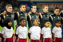 13.10.2014, City Stadium, Cardiff, WAL, UEFA Euro Qualifikation, Wales vs Zypern, Gruppe B, im Bild Wales' Simon Church, Hal Robson-Kanu, Gareth Bale, Chris Gunter and the mascots sing the national anthem // 15054000 during the UEFA EURO 2016 Qualifier group B match between Wales and Cyprus at the City Stadium in Cardiff, Wales on 2014/10/13. EXPA Pictures © 2014, PhotoCredit: EXPA/ Propagandaphoto/ David Rawcliffe<br /> <br /> *****ATTENTION - OUT of ENG, GBR*****