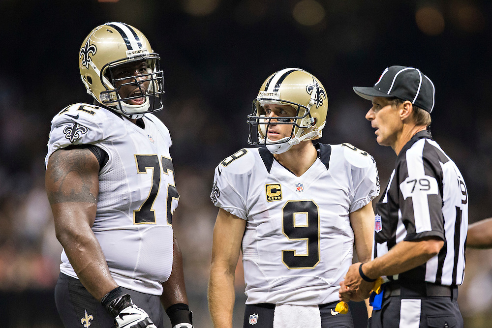 NEW ORLEANS, LA - SEPTEMBER 20:  Drew Brees #9 looks at Terron Armstead #72 of the New Orleans Saints during a game against the Tampa Bay Buccaneers at Mercedes-Benz Superdome on September 20, 2015 in New Orleans Louisiana.  The Buccaneers defeated the Saints 26-19. (Photo by Wesley Hitt/Getty Images) *** Local Caption *** Drew Brees; Terron Armstead