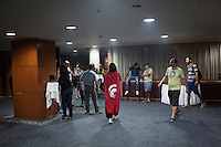 TUNIS, TUNISIA - 26 JULY 2013: A woman wearing a Tunisian flag walks in the lobby of the conference center of The Hotel Africa after a conference held by opposition members of the National Constituent Assembly, in Tunis, Tunisia, on July 26th 2013.<br /> <br /> Tunisia, birthplace of the Arab Spring revolutionary movement, was plunged into a new political crisis on Thursday when assassins shot Mohamed Brahmi, 58, leader of the Arab nationalist People's Party, an opposition party leader outside his home in a hail of gunfire.