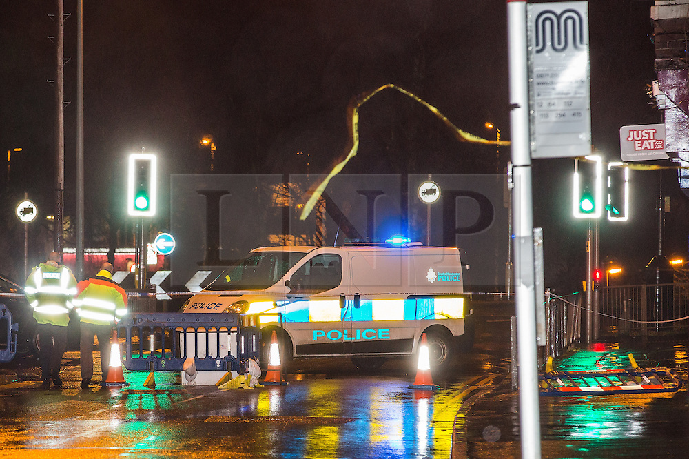 © Licensed to London News Pictures . 15/01/2015 . Middleton , UK . Police tape blows in the air as high winds blow out the gable end of a building on Market Place , Middleton , closing the road, as heavy rain and winds cause disruption across the UK .  Photo credit : Joel Goodman/LNP
