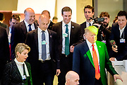Former economic advisor to Donald Trump, Gary Cohn (left) and former White House personal assistant John McEntee (center) follow behind US President Donald Trump down the stairs at the World Economic Forum - WEF in Davos in January 2018 while they both still had jobs in the Trump administration.