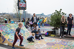 London, UK. 16th April 2019. Climate change activists from Extinction Rebellion, including many families, occupy Waterloo Bridge on the second day of International Rebellion activities to call on the British government to take urgent action to combat climate change.