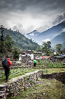Trekkers arriving in Shyauli Village on the Annapurna Trail, Nepal.