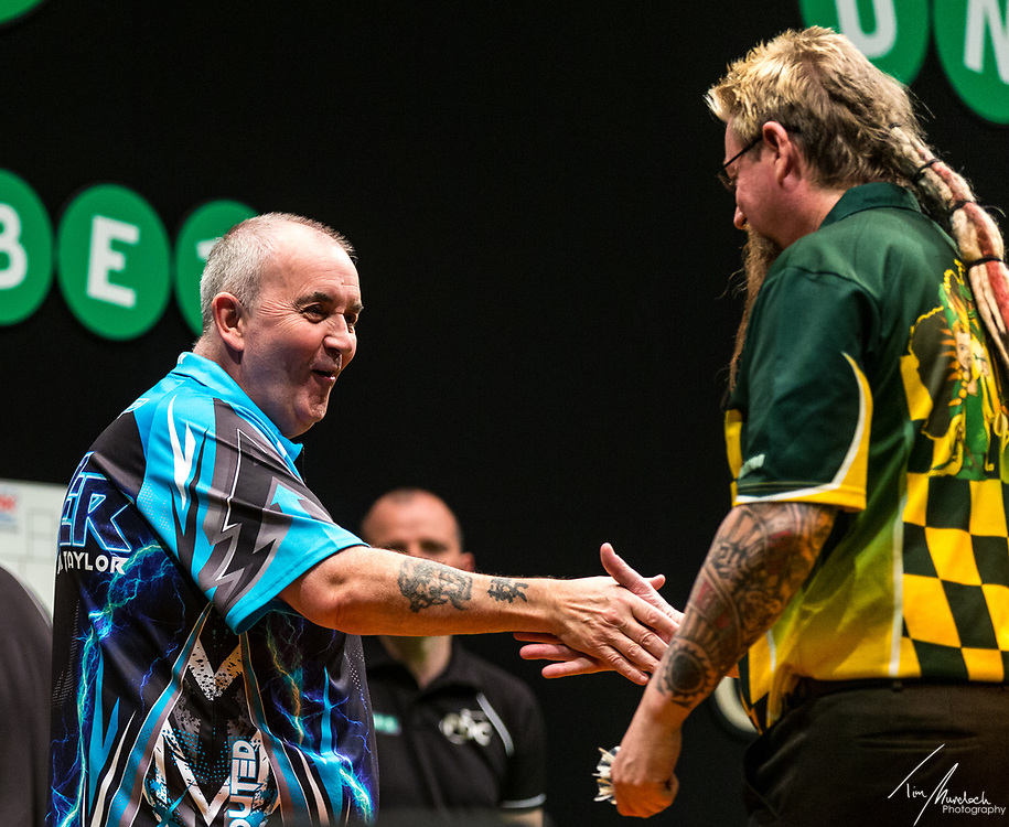 MELBOURNE, Australia - Sunday 20 August 2017:  Simon Whitlock congratulates Phil Taylor after taking out the second semi final of the Unibet Melbourne Dart Masters at Hisense Arena on Sunday 20 August 2017.<br /> <br /> Photo Credit: Tim Murdoch/Tim Murdoch Photography