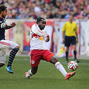 Pegguy Luyindula, (right), New York Red Bulls, is challenged by Jermaine Jones, New England Revolution, during the New York Red Bulls Vs New England Revolution, MLS Eastern Conference Final, first leg at Red Bull Arena, Harrison, New Jersey. USA. 23rd November 2014. Photo Tim Clayton