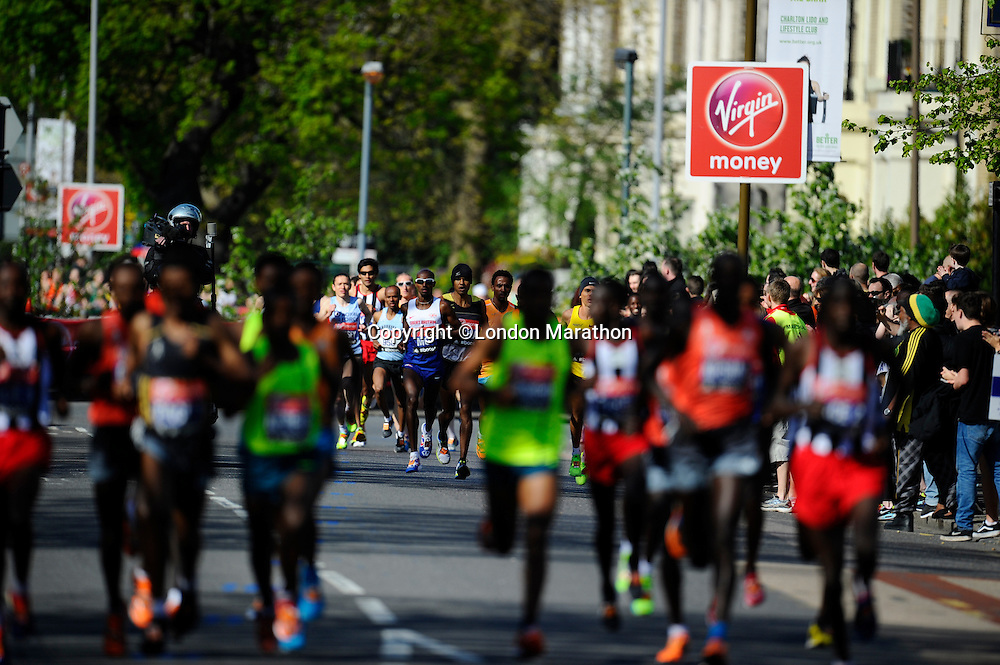 Mo Farah of Great Britain trails behind the leaders<br /> The Virgin Money London Marathon 2014<br /> 13 April 2014<br /> Photo: Javier Garcia/Virgin Money London Marathon<br /> media@london-marathon.co.uk