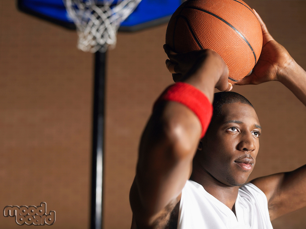 Basketball player preparing to throw ball portrait