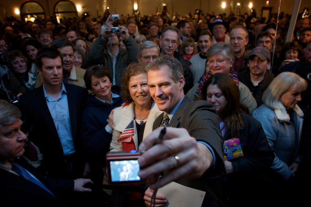 (013110  Foxboro, Mass.)  BROWN  U.S. Senator-elect Scott Brown snaps a self-portrait with supporter Ann Power of Stoughton at Christina's in Foxboro, his last scheduled public appearance before heading to Washington, on Jan. 31, 2010. Herald Photo by KELVIN MA. Saved in Sunday.