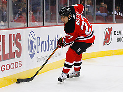 Oct 24, 2008; Newark, NJ, USA; New Jersey Devils defenseman Mike Mottau (27) skates with the puck during the first period at the Prudential Center.