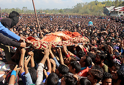 October 14, 2017 - Shopain, Jammu And Kashmir, India - Thousands pay respect as they pass the body of Lashkar-e-Toiba commander Wasim Shah alias Usama at Heff during funeral parade south Kashmir's Shopian district. Shah was killed with his comrade Naseer Mir on Saturday in an gunfight with government forces in south Kashmirs Pulwama district. (Credit Image: © Aasif Shafi/Pacific Press via ZUMA Wire)