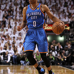Jun 17, 2012; Miam, FL, USA; Oklahoma City Thunder point guard Russell Westbrook (0) brings the ball up the court during the second quarter in game three in the 2012 NBA Finals against the Miami Heat at the American Airlines Arena. Mandatory Credit: Derick E. Hingle-US PRESSWIRE