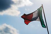 Italian flag over Lamborghini hospitality.