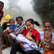 Mothers and kids are heading off after a Mother Support Group session where breast feeding mothers with 4 months plus babies learn about food supplements. Food workshop Billum Hatu, hamlet of Madabenu. Aidiu district..Infant mortality rates are very high in Timor-Leste and one of the reasons for that is poor nutrition. Alola advocate breast feeding till at least two years old and teach women about nutritious supplements such as boiled and mashed rice w vegetables and eggs.  Fundasaun Alola is a not for profit non government organization operating in Timor Leste to improve the lives of women and children. Founded in 2001 by the then First Lady, Ms Kirsty Sword Gusmao, the organization seeks to nurture women leaders and advocate for the rights of women.