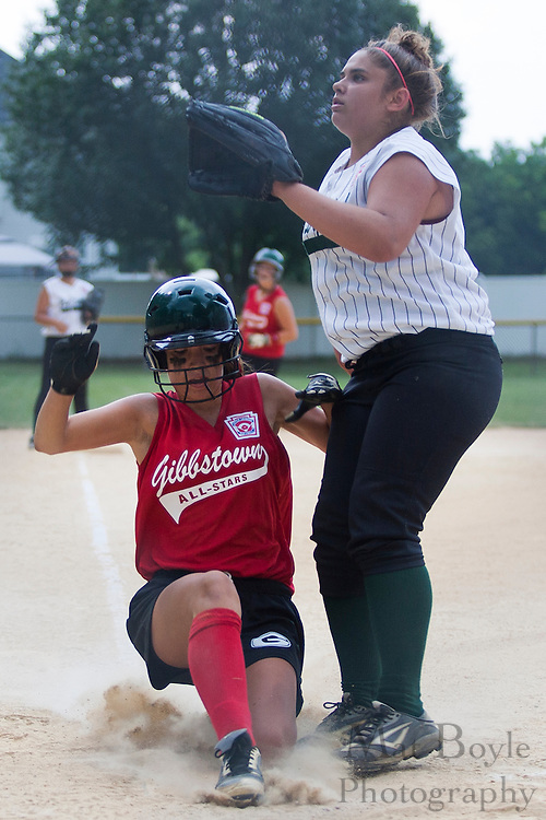Gibbstown's Taylor Pettit slides into home while West Deptford pitcher  Brittany Short waits for the ball during a game Thursday July 11, 2011 at Clayton Little League Complex.