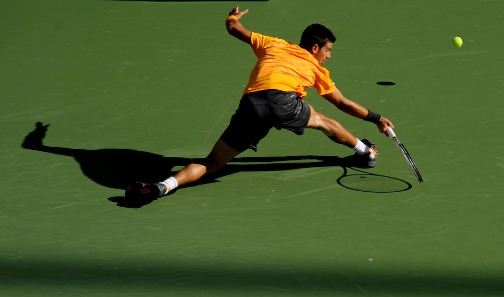 NEW YORK - SEPTEMBER 01: Novak Djokovic stretches to return a shot from Ivan Ljubicic during day two of the 2009 U.S. Open at the USTA Billie Jean King National Tennis Center on September 1, 2009 in Flushing neighborhood of the Queens borough of New York City. (Photo by Rob Tringali) *** Local Caption *** Novak Djokovic