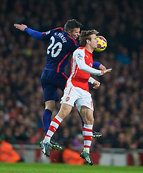 LONDON, ENGLAND - Saturday, November 22, 2014: Arsenal's Nacho Monreal and Manchester United's Robin van Persie during the Premier League match at the Emirates Stadium. (Pic by David Rawcliffe/Propaganda)
