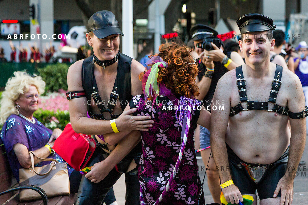 A man takes a photo of a group of friends dressed in Leather chaps during the Sydney Gay and Lesbian Mardi Gras parade. The Sydney Gay & Lesbian Mardi Gras is amongst the worlds most spectacular celebrations of LGBTQ pride and diversity.