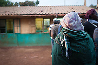 Voters line up just after dawn at Olympic Primary School Polling Station, Kibera, Nairobi, Kenya.