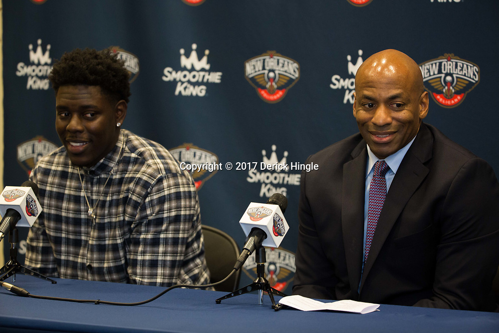 Jrue Holiday and general manager Dell Demps speak to the media during a press conference announcing, the free agent guard has signed a new five year contract to remain with the New Orleans Pelicans at the New Orleans Pelicans practice facility in Metairie, La. Thursday, July 6, 2017.