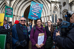 © Licensed to London News Pictures. 27/02/2020. London, UK. Friends of the Earth lawyer Katie de Kauwe (centre) leaves the High Court with her father (L) after judges ruled that the planned expansion of Heathrow Airport was illegal over climate change. Photo credit: Rob Pinney/LNP
