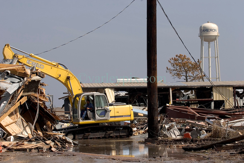 26th Sept, 2005. Cameron, Louisiana. Hurricane Rita aftermath.<br /> The destroyed remains of  downtown business in Cameron, Louisiana two days after the storm ravaged the small town. Wrecking crews move in to start the process of clearing the debris from the town.<br /> Photo; ©Charlie Varley/varleypix.com