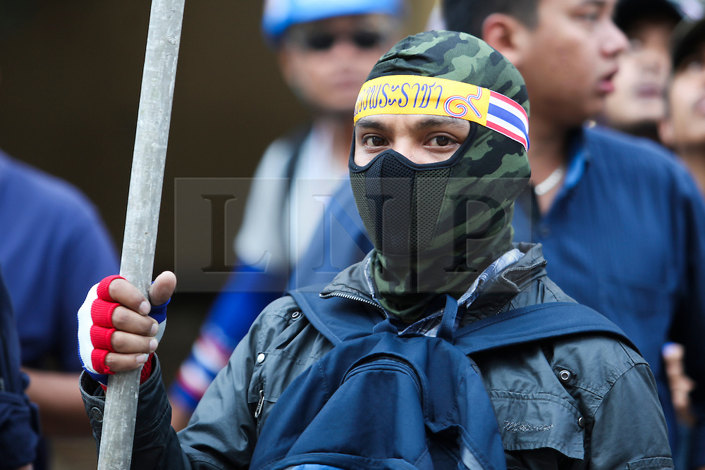 © Licensed to London News Pictures. 17/01/2014. An Anti-Goverment protestor after a suspect threw an explosive device injuring eight people during an anti-government street rally on January 17, 2014 in Bangkok, Thailand. Anti-government protesters launch 'Bangkok Shutdown', blocking major intersections in the heart of the capital, as part of their bid to oust the government of Prime Minister Yingluck Shinawatra ahead of elections scheduled to take place on February 2. Photo credit : Asanka Brendon Ratnayake/LNP