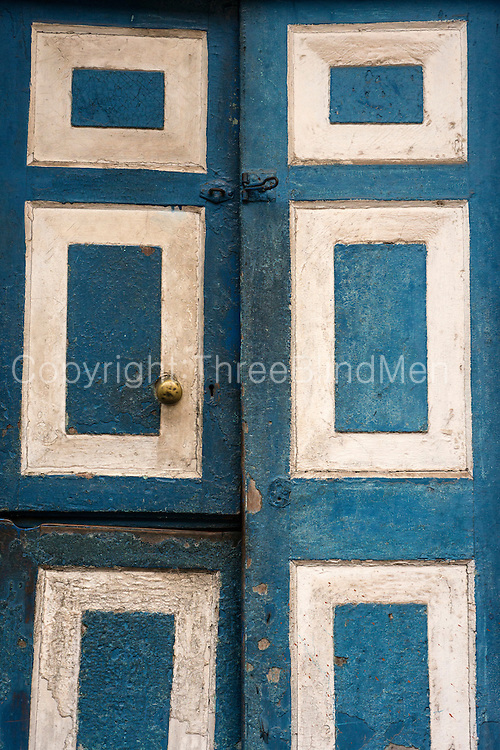 Old doorway with traditional blue and white panels, on Hultsdorf Street, Colombo.