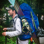 Portrait of professional free skier Andy Mahre with loaded backpack.