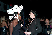 YAOUROU KONATE; ERIN O'CONNOR, Grey Goose character and cocktails. The Elton John Aids Foundation Winter Ball. off Nine Elms Lane. London SW8. 30 October 2010. -DO NOT ARCHIVE-© Copyright Photograph by Dafydd Jones. 248 Clapham Rd. London SW9 0PZ. Tel 0207 820 0771. www.dafjones.com.