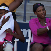 Serena Williams (right) and Sister Venus Williams, USA, playing in the Women's doubles event against Goerges and Parra Santonja during the US Open Tennis Tournament at Flushing Meadows, New York, USA, on Thursday September 3, 2009. Photo Tim Clayton.