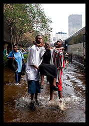 1st Sept, 2005. Mass evacuation of New Orleans begins. Grandsons struggle to carry their Grandmother onto the first convoy of busses to leave New Orleans.