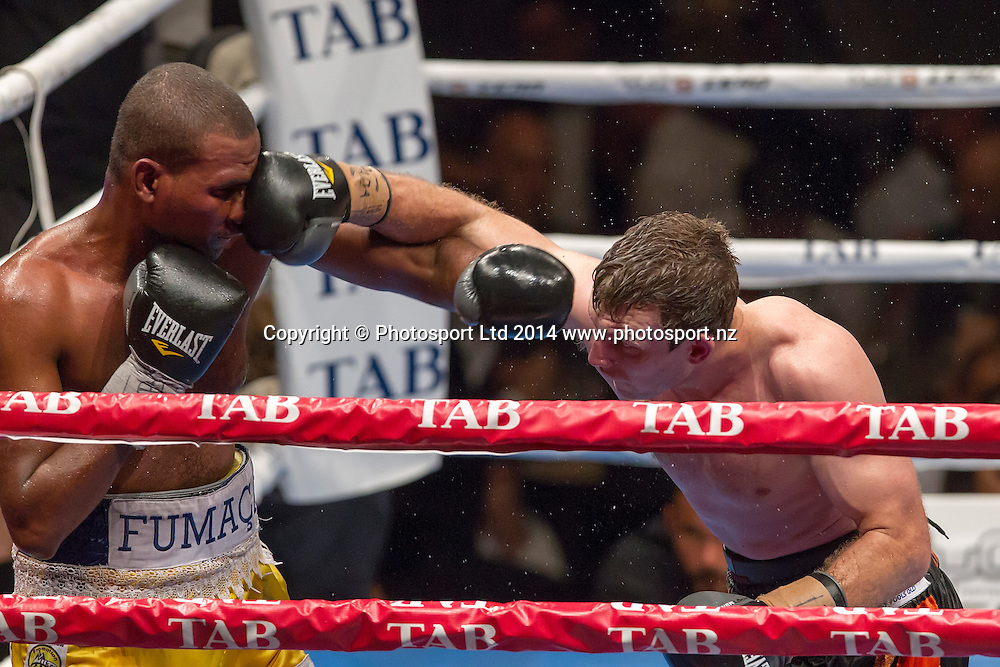 Brazilian Fernando Ferreira da Silva  left, fights Australian Jeff (The Hornet) Horn at the Hydr8 Zero Heavyweight Explosion, Vodafone Events Centre, Auckland, New Zealand, Saturday, July 05, 2014. Photo: David Rowland/Photosport