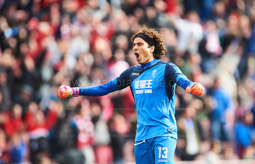 GRANADA, SPAIN - DECEMBER 03:  Francisco Guillermo Ochoa of Granada CF celebrates after scoring his team mate David Rodriguez Lomban of Granada CF during the La Liga match between Granada CF and Sevilla FC at Estadio Nuevos Los Carmenes on December 03, 2016 in Granada, Spain.  (Photo by Aitor Alcalde Colomer/Getty Images)