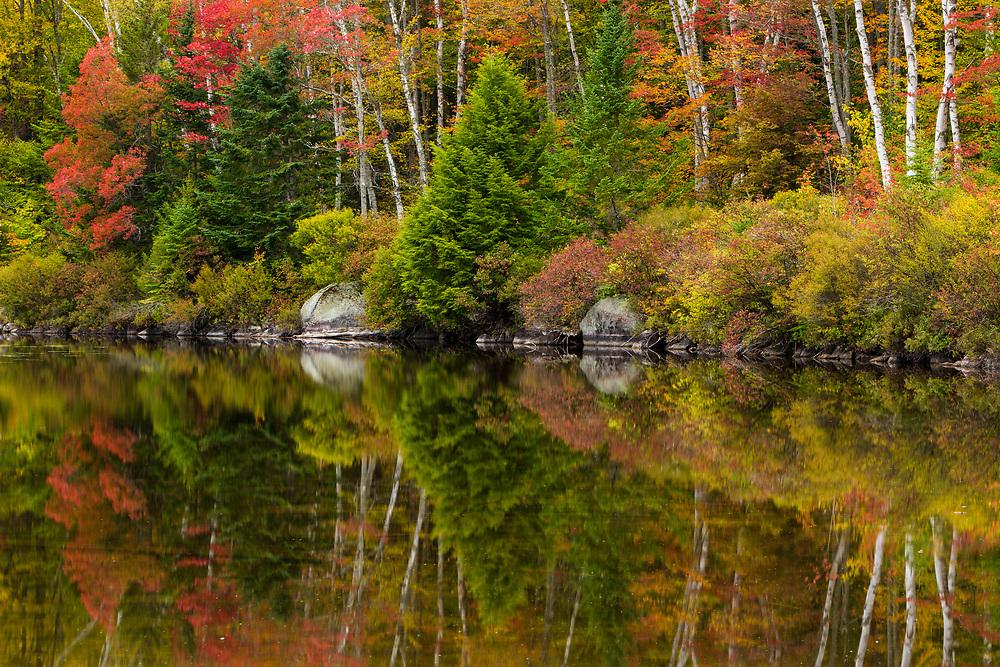 Peak autumn color graces Kettle Pond, Groton State Forest, Vermont