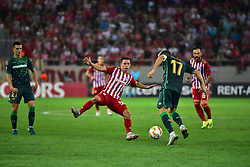 September 20, 2018 - Piraeus, Attiki, Greece - Daniel Podence (no 56) of Olympiacos is pressing Joaquin (no 17) of Real Betis. (Credit Image: © Dimitrios Karvountzis/Pacific Press via ZUMA Wire)