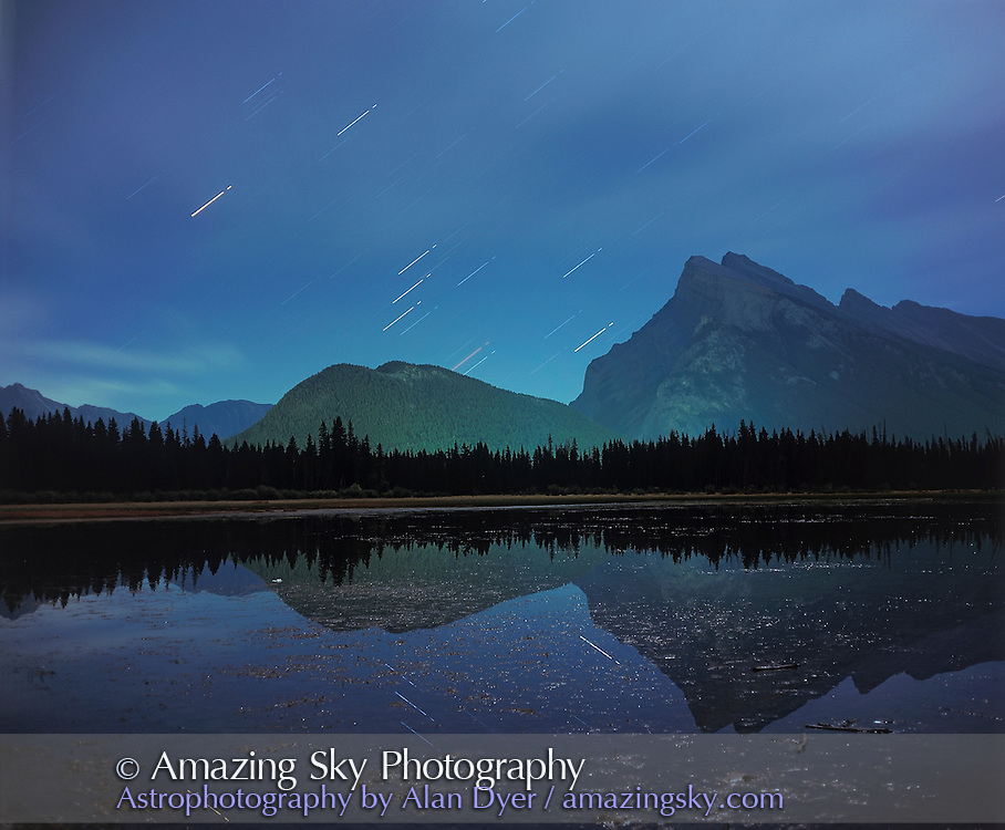 Orion rising in September, over Vermilion Lakes and Mt Rundle near Banff, Alberta...Taken in moonlight with Plaubel Makina 6x7 camera, and Fujichrome Velvia 50 slide film, 120-format. About 15 minute exposure at f5.6 followed by 30 second exposure at f2.8. Some cloud and green glow  on Tunnel Mtn is from Banff streetlights.