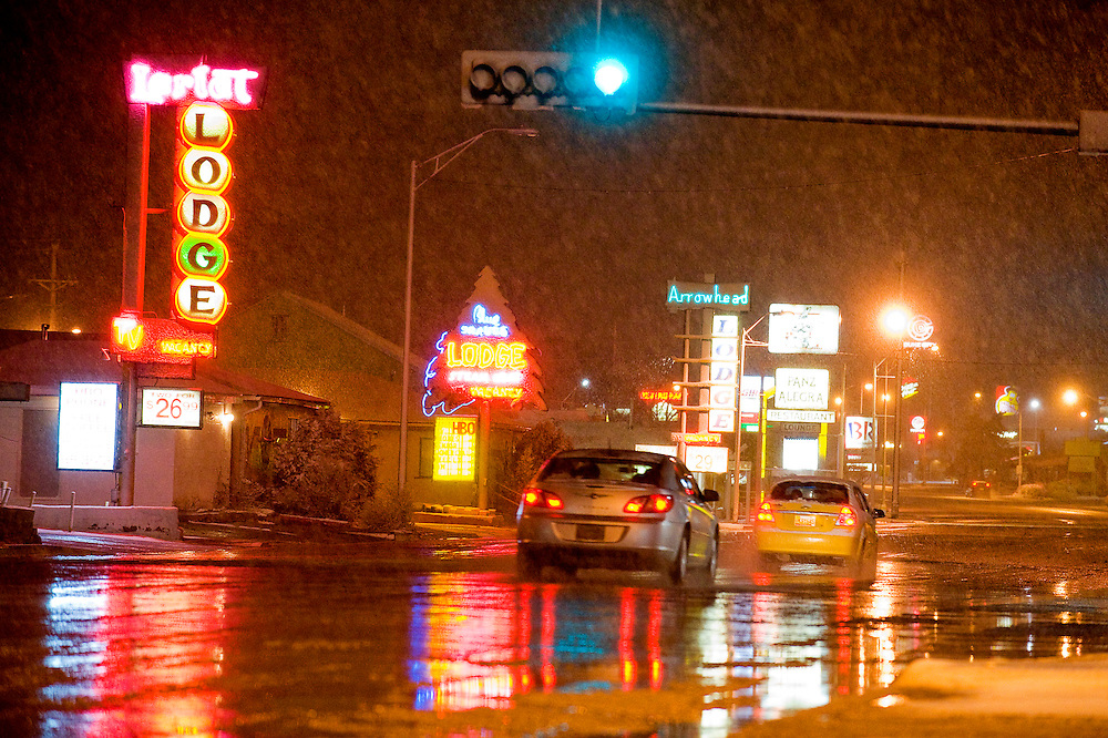 030711     Brian Leddy.Snow begins to coat Historic Route 66 in Gallup Monday evening. A heavy storm dropped about an inch of snow in the area.