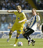Photo: Aidan Ellis.<br /> Sheffield Wednesday v Leeds United. Coca Cola Championship. 27/08/2006.<br /> Leeds Matthew Killgallon (L) and Wednesday's Chris Brunt