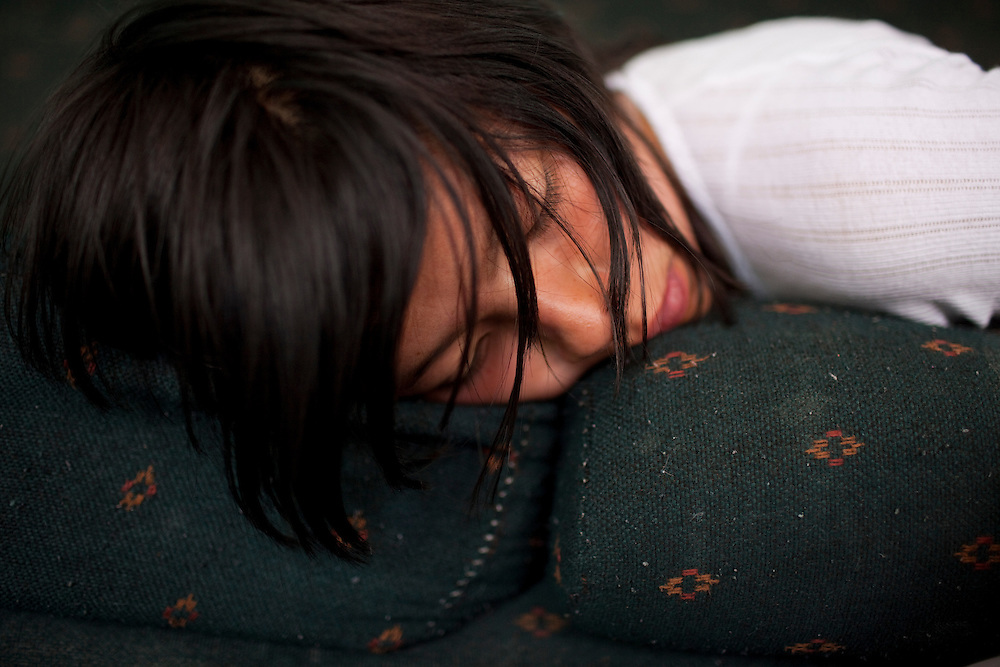 Denise Fuentes, 14, sleeps on her couch in Ciudad Juarez, Chihuahua Mexico on May 7, 2010. ..