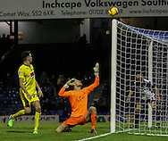 Daniel Bentley of Southend United (centre) watches as the ball hits the cross-bar and Tom Flanagan of Plymouth Argyle, currently on load from MK Dons,  (left) looks on during the Sky Bet League 2 match at Roots Hall, Southend<br /> Picture by David Horn/Focus Images Ltd +44 7545 970036<br /> 10/01/2015