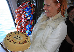 The organizer of the event Spela Predan with a cake for Jurij Golicic and Gregor Poloncic at whale watching boat, when some guys of Slovenian Team were celebrating an anniversary of playing for the team, during IIHF WC 2008 in Halifax,  on May 07, 2008, sea at Halifax, Nova Scotia, Canada. (Photo by Vid Ponikvar / Sportal Images)